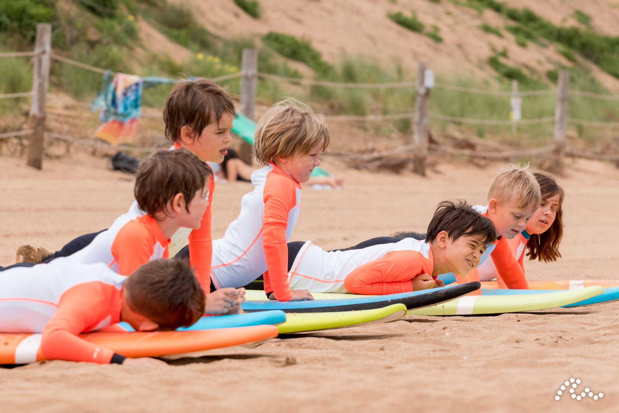 Family surfing at surf school